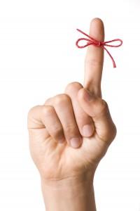 Reminder string tied around finger